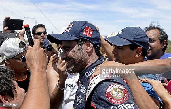 Mini's driver Nasser AlAttiyah of Qatar is congratulated by supporters after winning the Dakar 2015 second stage between Carlos Paz and San Juan...