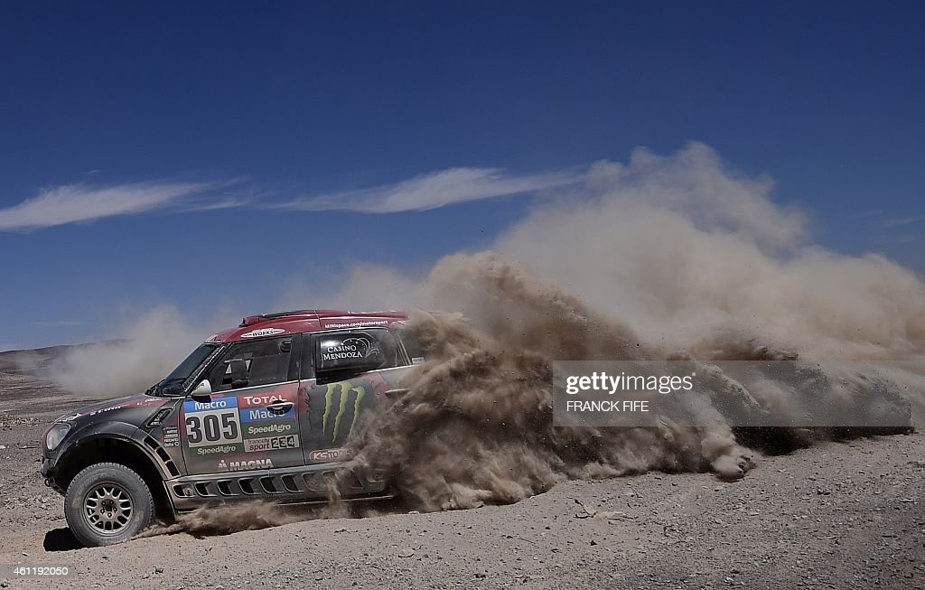 Mini's driver <a gi-track='captionPersonalityLinkClicked' href=/galleries/search?phrase=Orlando+Terranova&family=editorial&specificpeople=3945516 ng-click='$event.stopPropagation()'>Orlando Terranova</a> (R) of Argentina and co-driver Bernardo Graue compete during the Stage 5 of the Dakar 2015 between Copiapo and Antofogasta, Chile, on January 8, 2015. AFP PHOTO / FRANCK FIFE
