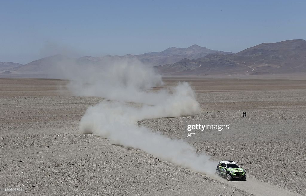Mini's driver Stephane Perterhansel and co-driver Jean Paul Cottret, both from France, compete during the Stage 13 of the 2013 Dakar Rally between Copiapo and La Serena, in Chile, on January 18, 2013. The rally is taking place in Peru, Argentina and Chile from January 5 to 20. AFP PHOTO / JACKY NAEGELEN / POOL