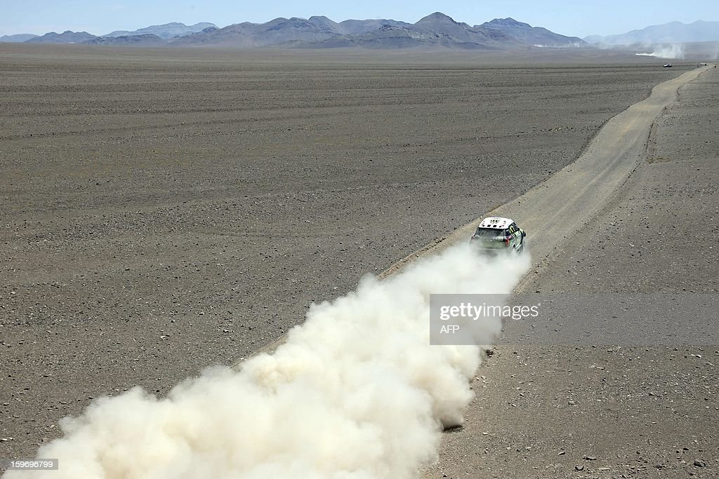 Mini's driver Stephane Perterhansel and co-driver Jean Paul Cottret, both from France, compete during the Stage 13 of the 2013 Dakar Rally between Copiapo and La Serena, in Chile, on January 18, 2013. The rally is taking place in Peru, Argentina and Chile from January 5 to 20.