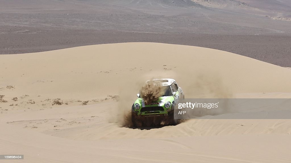 Mini's driver Stephane Perterhansel (R) of France and co-driver Jean Paul Cottret compete during the Stage 13 of the 2013 Dakar Rally between Copiapo and La Serena, in Chile, on January 18, 2013. The rally is taking place in Peru, Argentina and Chile from January 5 to 20.