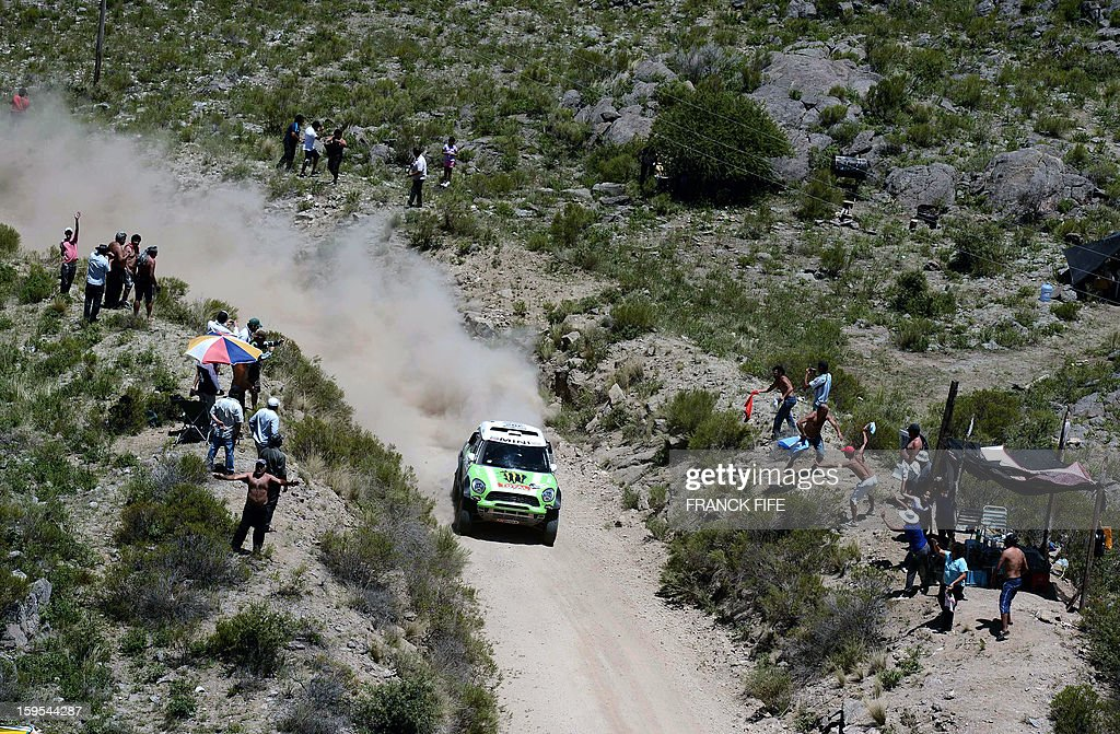 Mini's driver Stephane Perterhansel of France competes during the Stage 10 of the Dakar 2013 between Cordoba and La Rioja, Argentina, on January 15, 2013. The rally takes place in Peru, Argentina and Chile between January 5 and 20. AFP PHOTO / FRANCK FIFE