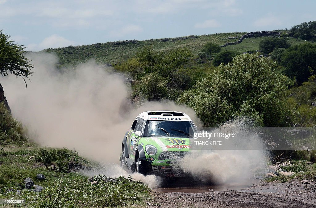 Mini's driver Stephane Perterhansel (R) of France competes during the Stage 9 of the Dakar 2013 between Tucuman and Cordoba, Argentina, on January 14, 2013. The rally takes place in Peru, Argentina and Chile from January 5 to 20.