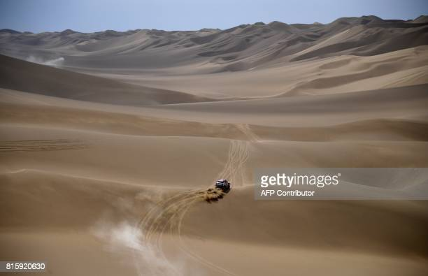 Mini's US drive Bryce Menzies and US codriver Peter Mortensen compete during the Stage 9 of the Silk Way 2017 between Urumqi and Hami China on July...