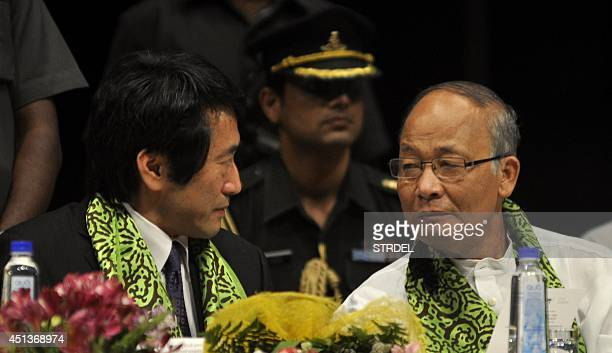 Minister and Deputy Chief of Mission from the Embassy of Japan Yasuhisa Kawamura speaks with the Chief Minister of the Indian state of Manipur Okram...