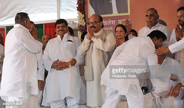 UP minister and Samajwadi Party leader Shivpal Singh Yadav and Rajya Sabha MP Amar Singh with other SP leaders at the inauguration of Janeshwar Misra...