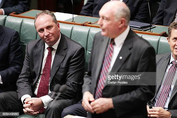 Minister for Agriculture and Water Resources Barnaby Joyce listens to Deputy Prime Minister Warren Truss announce his retirement in the House of...