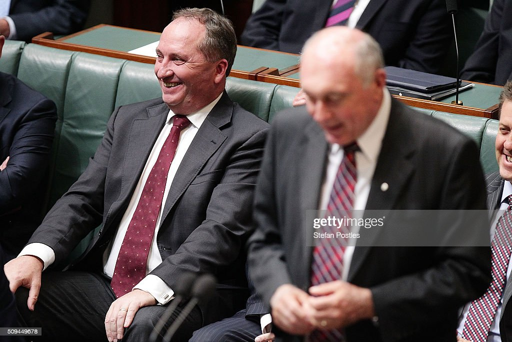 Minister for Agriculture and Water Resources Barnaby Joyce listens to Deputy Prime Minister Warren Truss announce his retirement in the House of Representatives on February 11, 2016 in Canberra, Australia. Nationals Leader and Deputy Prime Minister Warren Truss and Trade Minister Andrew Robb will retire at the next election.
