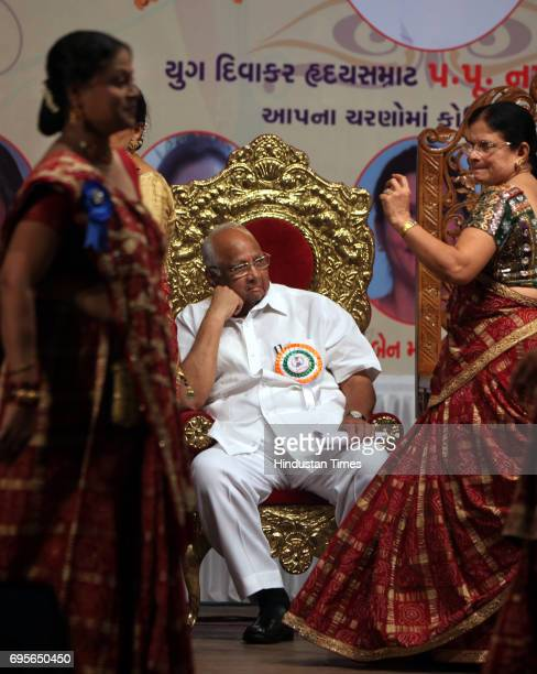 Minister for Agriculture Sharad Pawar watching a Gujarati cultural dance after inaugurating the Zalawad ladies group at Bhaidas Hall on Sunday Morning