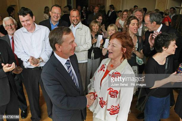 Minister for Arts Martin Cullen congratulates Olive Braiden on her retirement from the Arts Council in Newman House Dublin at the launch of Ireland's...