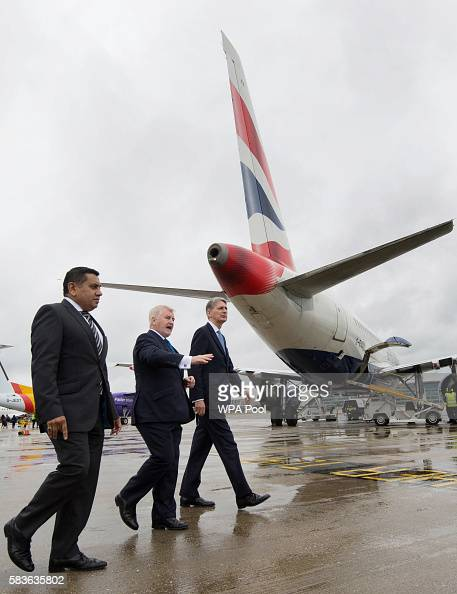 Minister for Aviation Lord Ahmad Declan Collier CEO of London City Airport and Chancellor Phillip Hammond during a visit to London City Airport on...