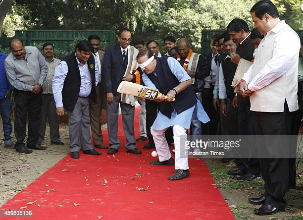 Minister for Chemicals and Fertilizers Ananth Kumar trying to play blind cricket on November 24 at 6 Tughlak Crescent Tughlak Road in New Delhi India...