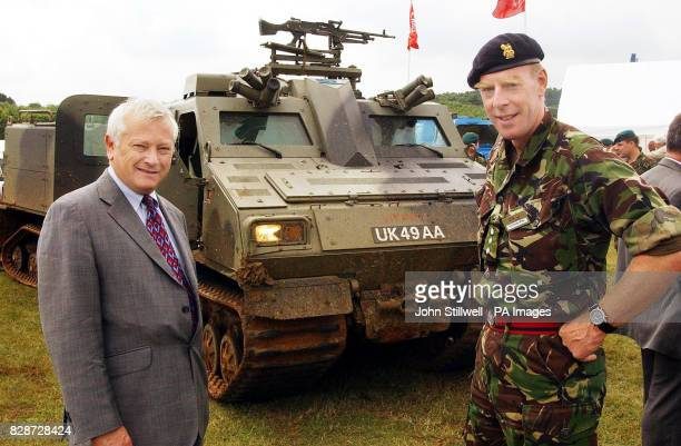 Minister for Defence Procurement Lord Bach with Colonel Carew Wilks stand in front of a Viking armoured all terrain vehicle at the Defence Vehicle...