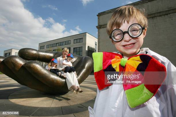Minister for Education and Science Mary Hanafin TD with four year olds Emma Broderick Julianne Gallagher and 'Professor' James Staines from...