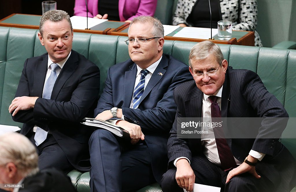 Minister for Education and Training Christopher Pyne, Minister for Social Services <a gi-track='captionPersonalityLinkClicked' href=/galleries/search?phrase=Scott+Morrison+-+Politician&family=editorial&specificpeople=15789813 ng-click='$event.stopPropagation()'>Scott Morrison</a> and Minister for Industry and Science Ian Macfarlane during House of Representatives question time at Parliament House on June 1, 2015 in Canberra, Australia.