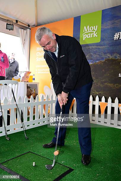 Minister for Enterprise Trade and Investment Jonathan Bell trying out an egg chipping contest during the second round of the Dubai Duty Free Irish...