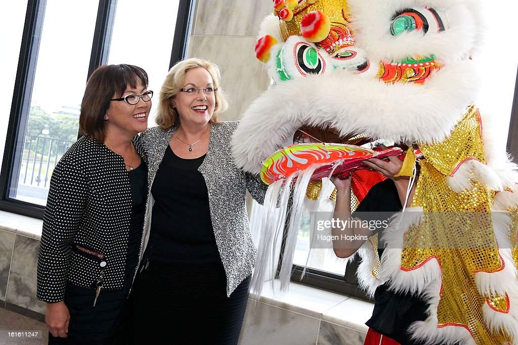 Minister for Ethnic Affairs, Judith Collins and Parliamentary Private Secretary for Ethnic Affairs, Melissa Lee, inspect a dragon during a Chinese New Year Celebration at The Beehive on February 13, 2013 in Wellington, New Zealand. Chinese New year celebrations begin on the first day of the first lunar month in the traditional Chinese calendar and end 15 days later on the full moon.