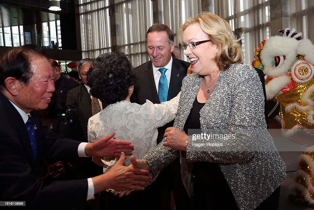 Minister for Ethnic Affairs, Judith Collins and Prime Minister <a gi-track='captionPersonalityLinkClicked' href=/galleries/search?phrase=John+Key&family=editorial&specificpeople=2246670 ng-click='$event.stopPropagation()'>John Key</a> greet guests during a Chinese New Year Celebration at The Beehive on February 13, 2013 in Wellington, New Zealand. Chinese New year celebrations begin on the first day of the first lunar month in the traditional Chinese calendar and end 15 days later on the full moon.
