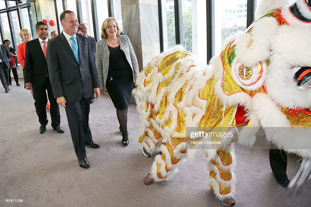 Minister for Ethnic Affairs, Judith Collins and Prime Minister <a gi-track='captionPersonalityLinkClicked' href=/galleries/search?phrase=John+Key&family=editorial&specificpeople=2246670 ng-click='$event.stopPropagation()'>John Key</a> follow dragon dancers into a Chinese New Year Celebration at The Beehive on February 13, 2013 in Wellington, New Zealand. Chinese New year celebrations begin on the first day of the first lunar month in the traditional Chinese calendar and end 15 days later on the full moon.