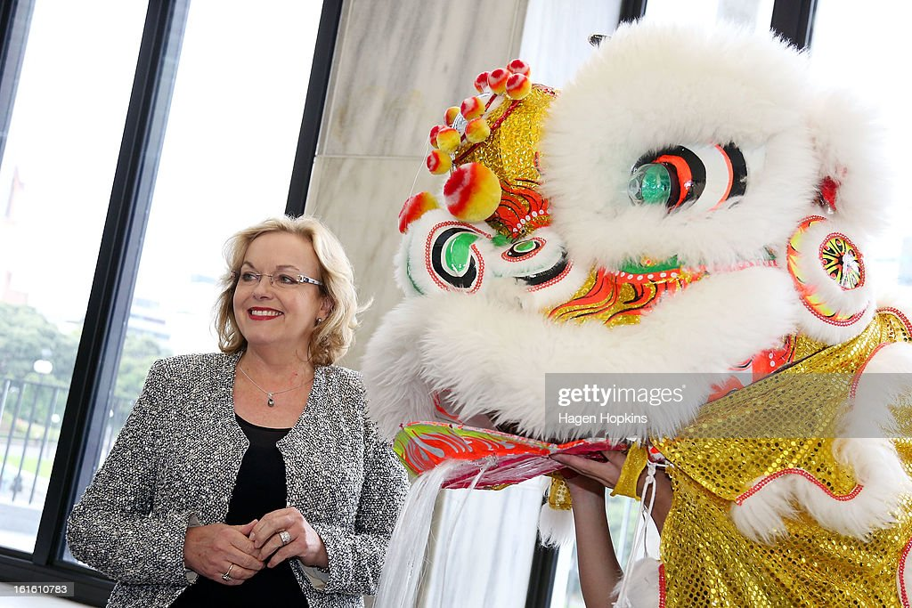 Minister for Ethnic Affairs, Judith Collins interacts with a dragon dancers during a Chinese New Year Celebration at The Beehive on February 13, 2013 in Wellington, New Zealand. Chinese New year celebrations begin on the first day of the first lunar month in the traditional Chinese calendar and end 15 days later on the full moon.