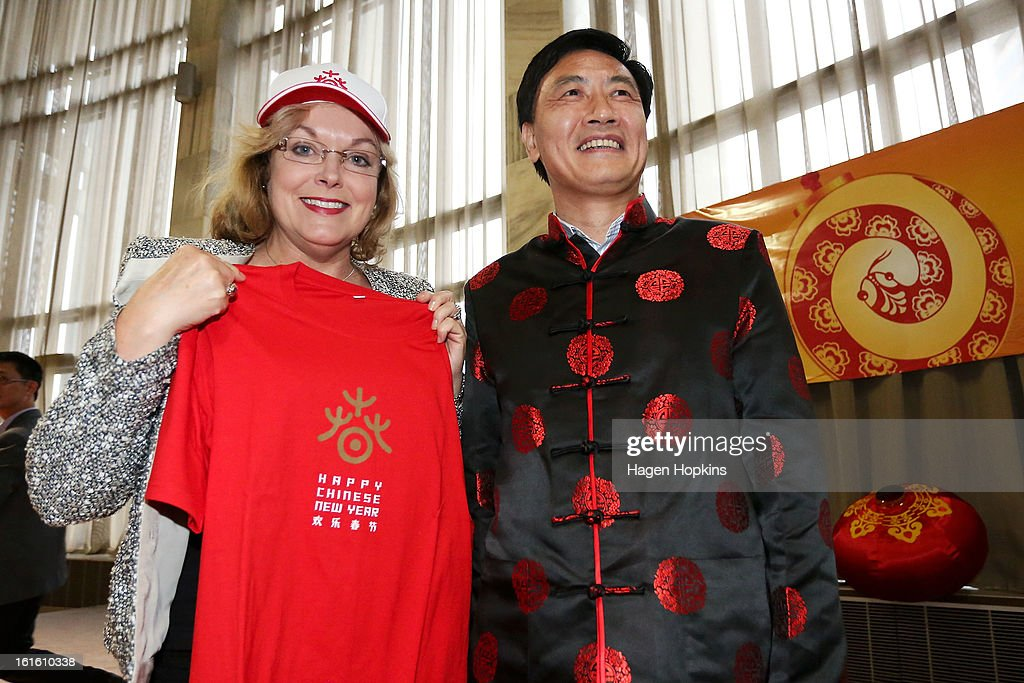 Minister for Ethnic Affairs, Judith Collins poses with Ambassador of the People's Republic of China, HE Mr Xu Jianguo, after receiving a t-shirt as a gift during a Chinese New Year Celebration at The Beehive on February 13, 2013 in Wellington, New Zealand. Chinese New year celebrations begin on the first day of the first lunar month in the traditional Chinese calendar and end 15 days later on the full moon.