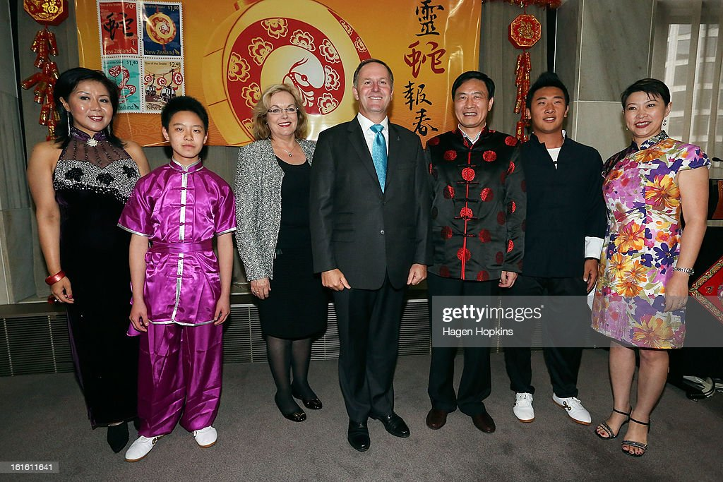 Minister for Ethnic Affairs, Judith Collins, Prime Minister John Key and Ambassador of the People's Republic of China, HE Mr Xu Jianguo, pose with performers during a Chinese New Year Celebration at The Beehive on February 13, 2013 in Wellington, New Zealand. Chinese New year celebrations begin on the first day of the first lunar month in the traditional Chinese calendar and end 15 days later on the full moon.