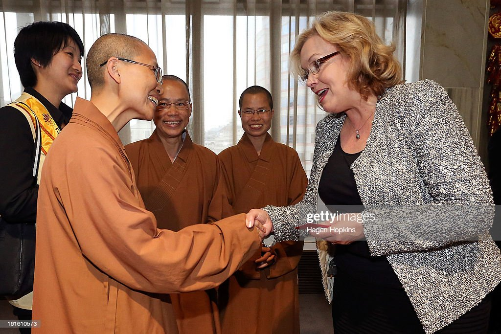 Minister for Ethnic Affairs, Judith Collins shakes hands with a member of Fo Guang Shan Buddhist Temple during a Chinese New Year Celebration at The Beehive on February 13, 2013 in Wellington, New Zealand. Chinese New year celebrations begin on the first day of the first lunar month in the traditional Chinese calendar and end 15 days later on the full moon.