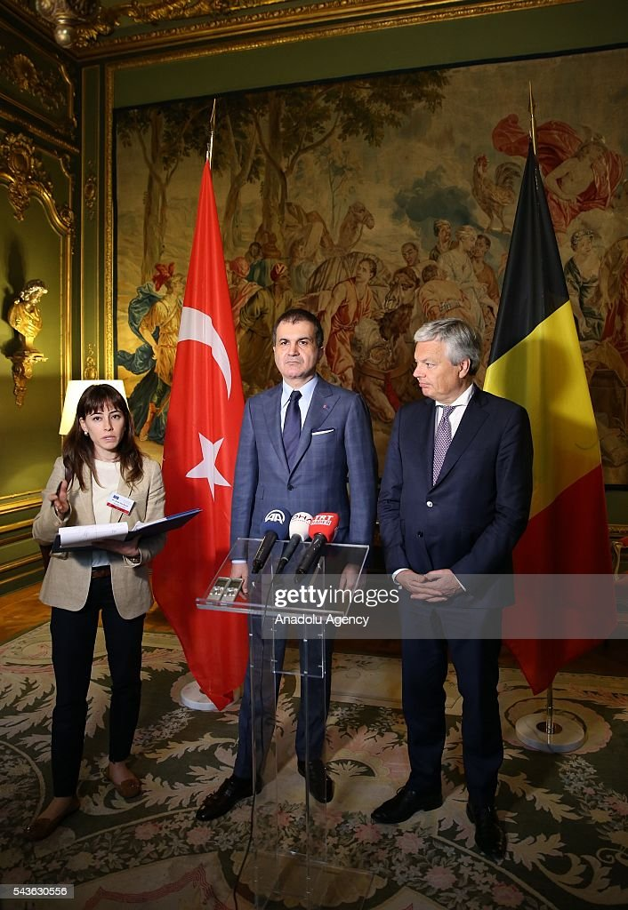 Minister for EU Affairs and Chief Negotiator of Turkey, Omer Celik (C) and Deputy Prime Minister and Foreign Affairs Minister of Belgium, Didier Reynders (R) hold a joint press conference following their meeting, in Brussels, Belgium on June 29, 2016.