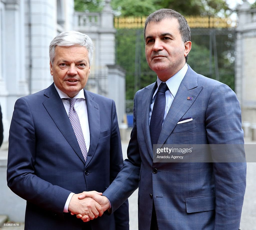 Minister for EU Affairs and Chief Negotiator of Turkey, Omer Celik (R) and Deputy Prime Minister and Foreign Affairs Minister of Belgium, Didier Reynders (L) shake each other's hands ahead of their meeting, in Brussels, Belgium on June 29, 2016.