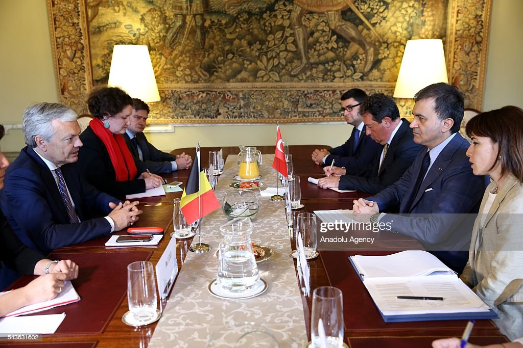 Minister for EU Affairs and Chief Negotiator of Turkey, Omer Celik (2nd R) meets with Deputy Prime Minister and Foreign Affairs Minister of Belgium, Didier Reynders (L) in Brussels, Belgium on June 29, 2016.