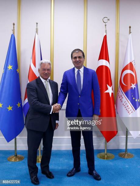Minister for European Union Affairs of Turkey Omer Celik and United Kingdom Foreign Office Minister Alan Duncan shake their hands ahead of a joint...