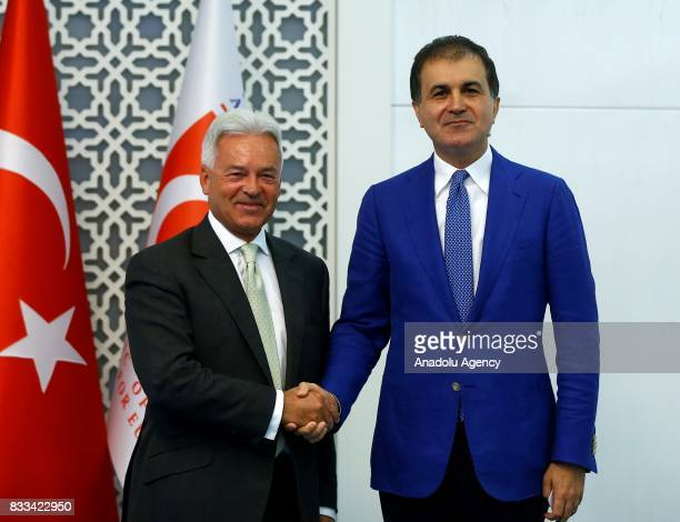 Minister for European Union Affairs of Turkey Omer Celik and United Kingdom Foreign Office Minister Alan Duncan shake their hands after a joint press...