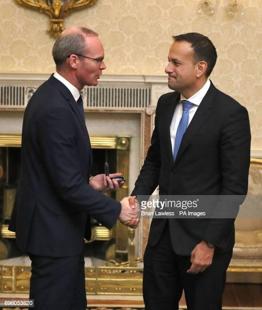 Minister for Foreign Affairs and Trade Simon Coveney with Fine Gael leader and Taoiseach Elect Leo Varadkar at the signing into government of the...