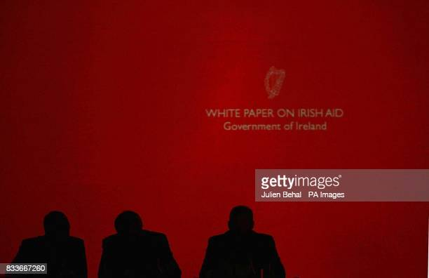 Minister for Foreign Affairs Dermot Ahern Taoiseach Bertie Ahern TD and Minister Conor Lenihan TD in front of the visual back drop of overseas...