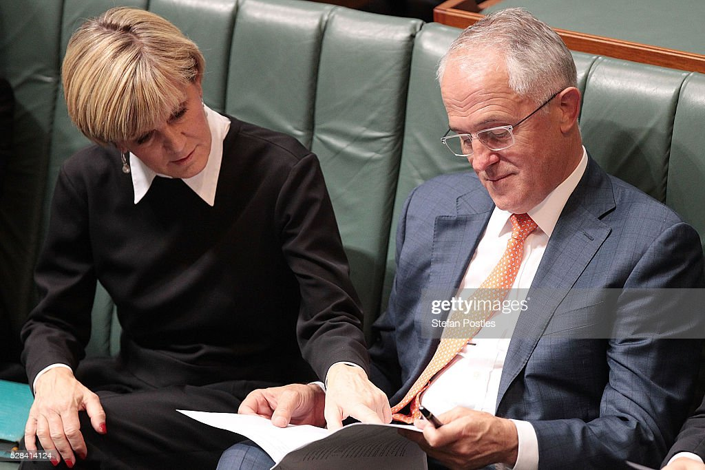 Minister for Foreign Affairs <a gi-track='captionPersonalityLinkClicked' href=/galleries/search?phrase=Julie+Bishop&family=editorial&specificpeople=1198450 ng-click='$event.stopPropagation()'>Julie Bishop</a> and Prime Minister <a gi-track='captionPersonalityLinkClicked' href=/galleries/search?phrase=Malcolm+Turnbull&family=editorial&specificpeople=2125595 ng-click='$event.stopPropagation()'>Malcolm Turnbull</a> during Opposition leader Bill Shorten's budget reply speech on May 5, 2016 in Canberra, Australia. The Turnbull Government's first budget has delivered tax cuts for small and medium businesses, income tax cuts people earning over $80,000 a year,new measures to help young Australians into jobs and cutbacks to superannuation concessions for the wealthy.