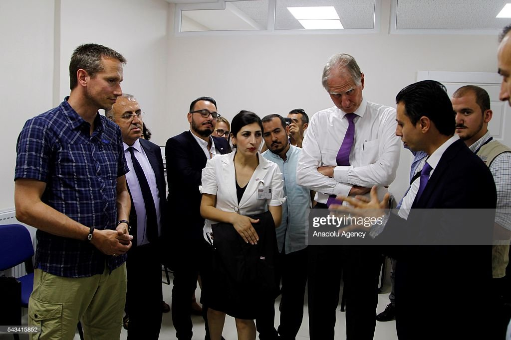 Minister for Foreign Affairs of Denmark, Kristian Jensen (L) visits community center for Syrian refugees in Onikisubat district of Kahramanmaras, Turkey on June 28, 2016.