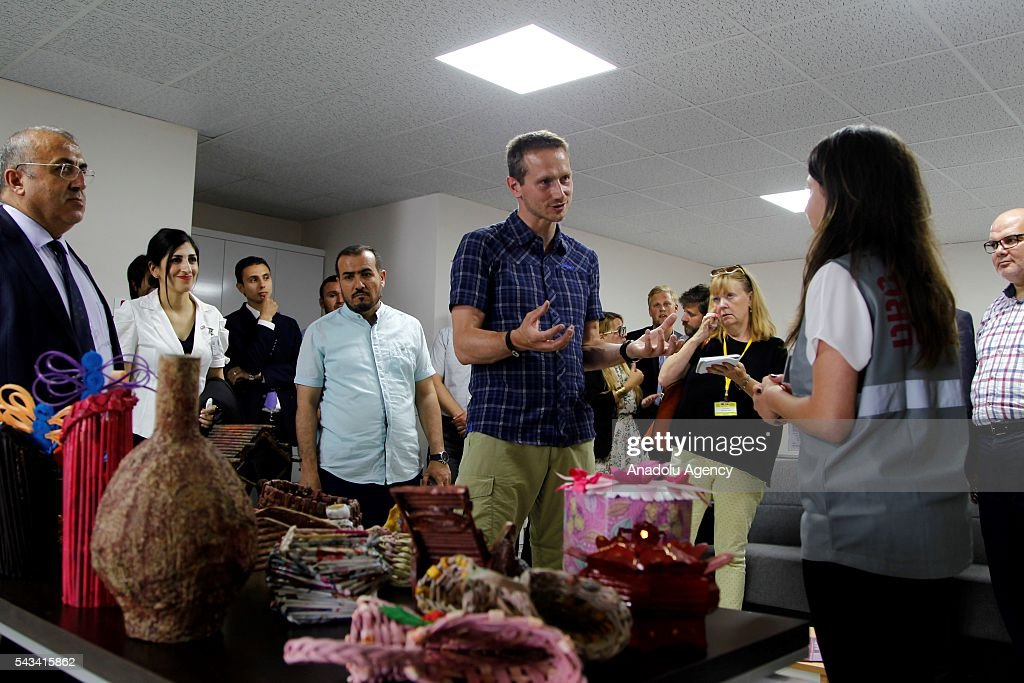 Minister for Foreign Affairs of Denmark, Kristian Jensen (C) visits community center for Syrian refugees in Onikisubat district of Kahramanmaras, Turkey on June 28, 2016.