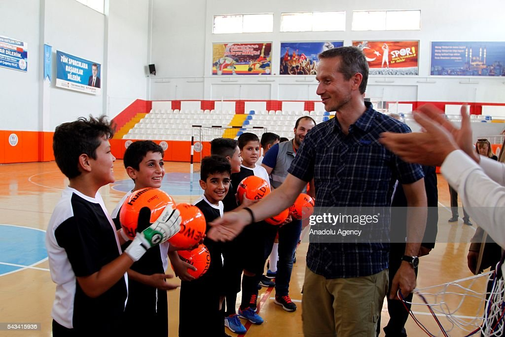 Minister for Foreign Affairs of Denmark, Kristian Jensen (R) visits community center for Syrian refugees in Onikisubat district of Kahramanmaras, Turkey on June 28, 2016.