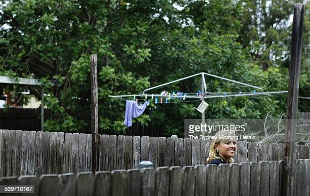 NSW Minister for Housing Cherie Burton in the backyard of the housing commission home that she grew up in Minto 18 February 2006 SMH Picture by...