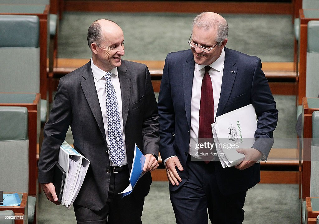 Minister for Human Services Stuart Robert and Treasurer Scott Morrison arrive at House of Representatives question time at Parliament House on February 10, 2016 in Canberra, Australia.