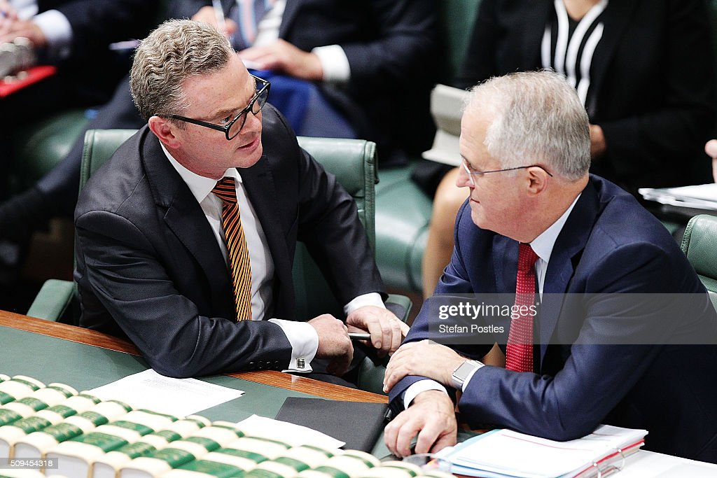 Minister for Industry, Innovation and Science Christopher Pyne speaks with Prime Minister <a gi-track='captionPersonalityLinkClicked' href=/galleries/search?phrase=Malcolm+Turnbull&family=editorial&specificpeople=2125595 ng-click='$event.stopPropagation()'>Malcolm Turnbull</a> during House of Representatives question time at Parliament House on February 11, 2016 in Canberra, Australia. Nationals Leader and Deputy Prime Minister Warren Truss and Trade Minister Andrew Robb will retire at the next election.