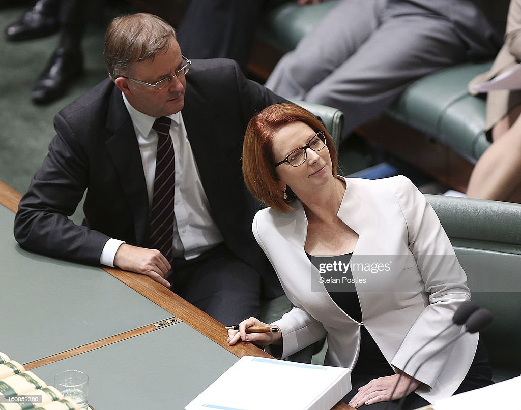 Minister for Infrastructure and Transport Anthony Albanese speaks with Prime Minister <a gi-track='captionPersonalityLinkClicked' href=/galleries/search?phrase=Julia+Gillard&family=editorial&specificpeople=787281 ng-click='$event.stopPropagation()'>Julia Gillard</a> during House of Representatives question time at Parliament House on February 7, 2013 in Canberra, Australia. Parliament resumes for the first sitting of 2013 this week, just days after Prime Minister Gillard, announced a federal election date of September 14, 2013.