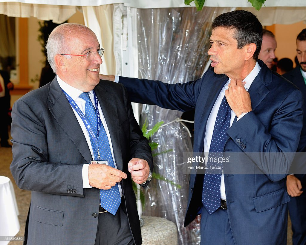 Minister for Infrastructure and Trasport Maurizio Lupi and <a gi-track='captionPersonalityLinkClicked' href=/galleries/search?phrase=Joaquin+Almunia&family=editorial&specificpeople=5521769 ng-click='$event.stopPropagation()'>Joaquin Almunia</a> attend the Ambrosetti International Economy Forum at Villa d'Este Hotel on September 7, 2014 in Como, Italy. 'Intelligence on the World, Europe and Italy' is the title of the workshop of the 40th edition of Ambrosetti International Economy Forum the intent of the workshop is to offer Italian and International decision-makers the opportunity for serious, high-level examination with the support of studies and statistics of geopolitical, economic, technological and social scenarios and their implication for business.