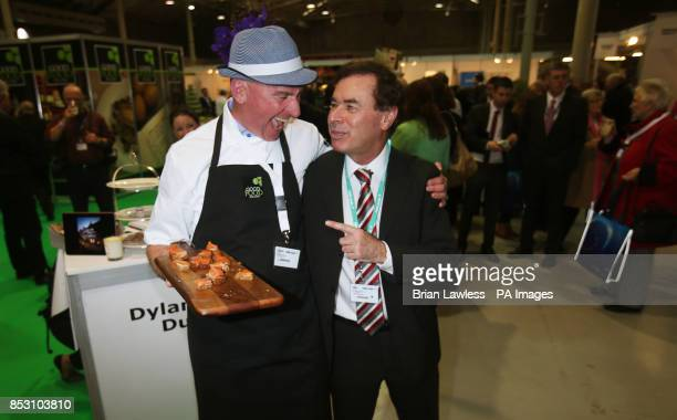 Minister for Justice Alan Shatter with fishmonger Pat O'Connell at the Fine Gael ard fheis at the RDS Dublin PRESS ASSOCIATION Photo Picture date...