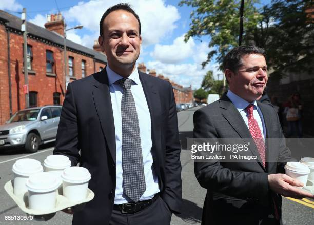 Minister for Social Protection Leo Varadkar and Minister for Public Expenditure and Reform Paschal Donohoe arrive with coffee to speak to the media...