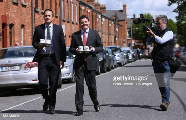 Minister for Social Protection Leo Varadkar and Minister for Public Expenditure and Reform Paschal Donohoe arrive to speak to the media on Leo Street...