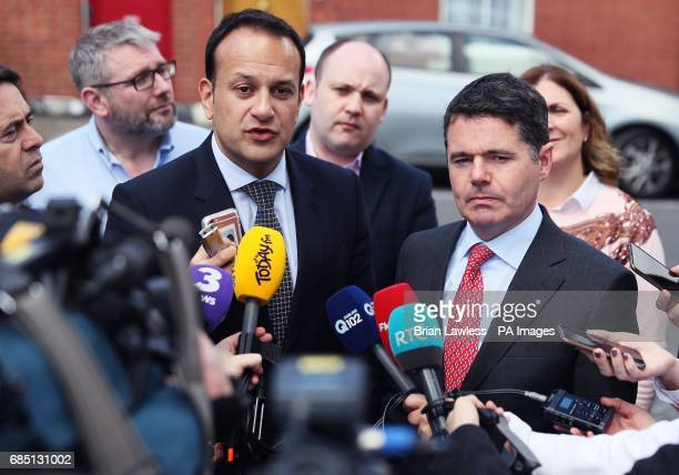 Minister for Social Protection Leo Varadkar and Minister for Public Expenditure and Reform Paschal Donohoe speak to the media on Leo Street in Dublin...