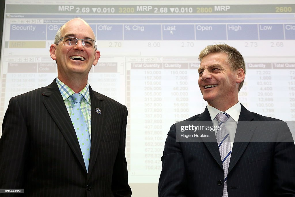 Minister for State Owned Enterprises, Tony Ryall, and Minister of Finance, <a gi-track='captionPersonalityLinkClicked' href=/galleries/search?phrase=Bill+English&family=editorial&specificpeople=772458 ng-click='$event.stopPropagation()'>Bill English</a> share a laugh during the listing of Mighty River Power at NZX on May 10, 2013 in Wellington, New Zealand. Mighty River Power is one of several state owned enterprises being partially sold by the Government to raise capital.
