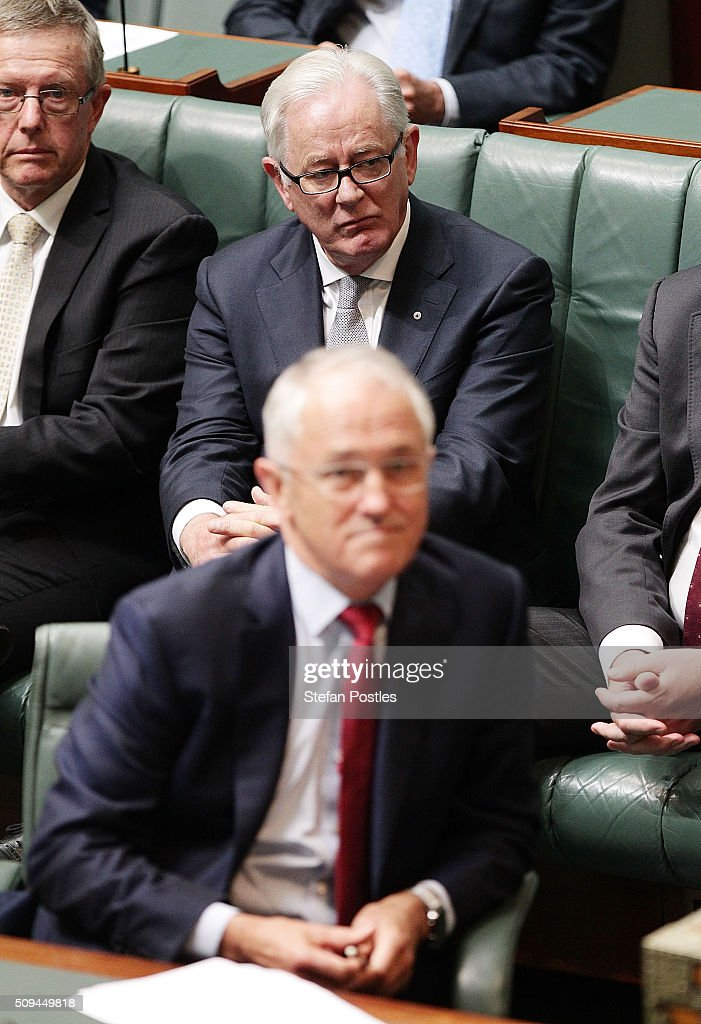 Minister for Trade and Investment Andrew Robb listens to Deputy Prime Minister Warren Truss announce his retirement in the House of Representatives on February 11, 2016 in Canberra, Australia. Nationals Leader and Deputy Prime Minister Warren Truss and Trade Minister Andrew Robb will retire at the next election.