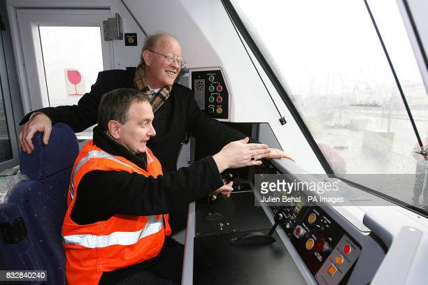 Minister for Transport Martin Cullen with the CIE Chairman DrJohn Lynch in the cabin of the new state of the art railcars deliverd today for Iarnrod...